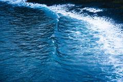 Detail of tidal ocean wave on beach Kuvituskuvat