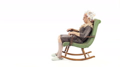 Grandmother have fun on rocking chair isolated on white Stock Footage