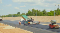 Works on asphalting the highway, JUNE 20, 2016 in Vilnius, Lithuania Stock Footage