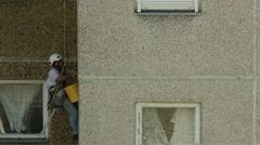 4K Steeplejack Working on a Concrete Building Block 2 Stock Footage