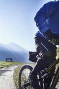 Mountain biker on dirt track, Valais, Switzerland - stock photo
