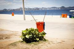 Wheelie bin on beach, Rio de Janeiro, Brazil Stock Photos