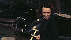 USA 1941: young woman in front of a car Stock Footage