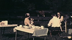 USA 1941: family having a picnic in the countryside Stock Footage