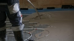 Pouring concrete on the floor with underfloor heating Stock Footage