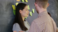 4K Portrait smiling man with colleagues, brainstorming with sticky notes - stock footage
