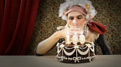 Senior woman is celebrating her birthday lighting up a cigar - stock footage