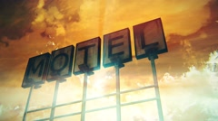 4K Old Grungy Motel Sign On the Road in a Wonderful Sunset with Lightrays 1 Stock Footage