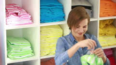 pretty elegant woman shopping in clothes store - stock footage