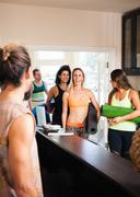 Mid adult woman arriving at yoga class Stock Photos