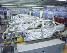 Car bodies on production line in car factory Kuvituskuvat