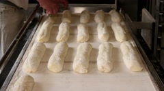 Baker preparing the bread dough before placing in hot oven - stock footage