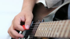 Guitarists hands playing song on electric guitar Stock Footage
