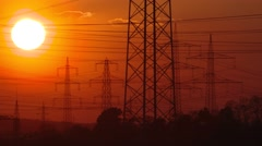 TIME LAPSE: Electrical power supply (electrical towers) with sunset in red sky Stock Footage
