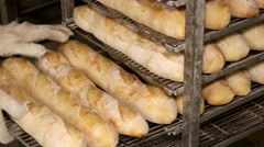 Fresh hot French baguettes in handcart from oven Stock Footage