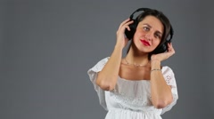Beautiful young girl dancing and singing with headphones Stock Footage