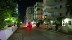 A police car with flashing beacons driving near the hotels Stock Footage