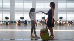 Little girl met her mother with suitcase in airport Stock Footage