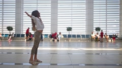 Little girl met her mother in airport with open arms Stock Footage