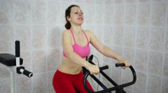 Young woman is doing strong exercise in a light gym. Stock Footage