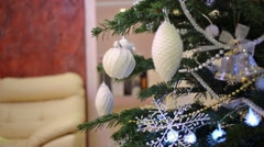 Close up view of artificial christmas tree with decoration is standing Arkistovideo