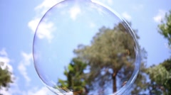 Close up view of beautiful big soap bubble is flying near the trees Stock Footage