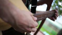 Close up view of musician is playing on his domra at summer day. Stock Footage