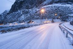 Snow covered highway at dusk, Reine, Lofoten, Norway Stock Photos