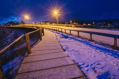Snow covered path and highway at night, Reine, Lofoten, Norway Stock Photos
