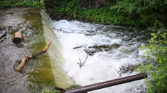 Beautiful waterfall with a stream  in green summer forest. Stock Footage