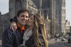 Romantic couple in front of St Bavo's Cathedral, Ghent, Flanders, Belgium Stock Photos