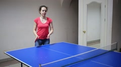 Young woman is playing in ping pong on a room with rival. Stock Footage