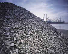 Metal ore on port quay - stock photo