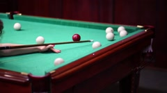Young woman is playing in a billiard with the cue. Stock Footage
