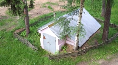 Top view of the old building near high trees  with fence. Stock Footage