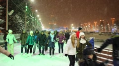 Crowd of people are skating on the ice in a skating-rink at VDNKH. Stock Footage