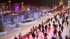 People are skating on the ice in a skating-rink of VDNKH. Stock Footage