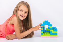 Seven-year girl has built a house of designer looks and fun in the frame - stock photo