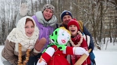 Family of four are standing near scarecrow for carnival. Stock Footage