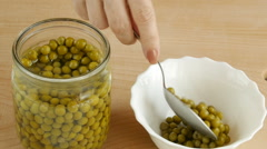 Canned peas in pot. - stock footage