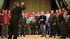 Director is conducting to company of MIA on the stage. Stock Footage