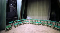 Many green old stools for choral people are standing at stage. Arkistovideo