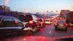 Large traffic jam with a many cars and red stop lights. Stock Footage