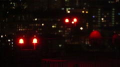 Two red lanterns are standing on the street at night. Stock Footage
