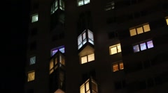 Facade with many windows and colorful garlands at the night. Stock Footage