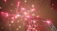 Many flashes of fireworks near houses at the evening. Stock Footage
