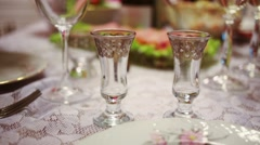 Table appointments with many different dishes and beverages. Stock Footage