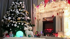 Beautiful decorated by toys and garlands christmas tree Stock Footage