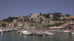 Pan across waterfront and promenade, Port of Soller, Mallorca, Spain Stock Footage