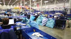 Workers sorts a packages at automated sorting center Russian Post Stock Footage